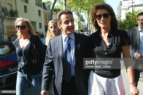 Nicolas Sarkozy France's UMP political party presidential candidate his wife Cecilia and her daughters Judith and JeanneMarie Martin as they arrive...