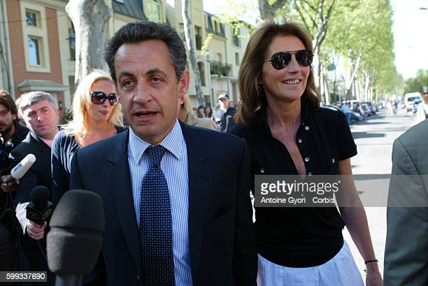 Nicolas Sarkozy France's UMP political party presidential candidate his wife Cecilia and her daughter Judith as they arrive at the polling station in...