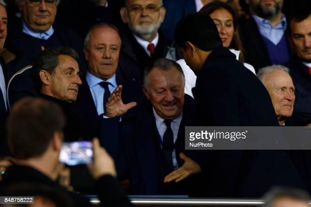 Nicolas Sarkozy JeanMichel Aulas Nasser AlKhelaïfi attend during the Ligue 1 match between Paris Saint Germain and Olympique Lyonnais at Parc des...
