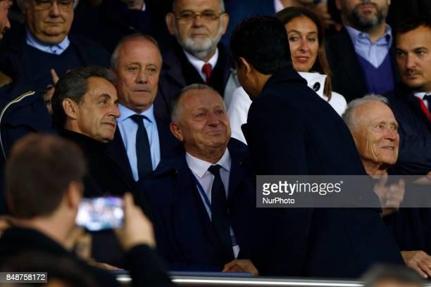 Nicolas Sarkozy JeanMichel Aulas Nasser AlKhelaïfi attend the Ligue 1 match between Paris Saint Germain and Olympique Lyonnais at Parc des Princes on...