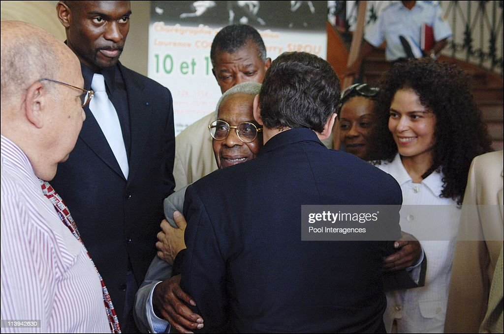<a gi-track='captionPersonalityLinkClicked' href=/galleries/search?phrase=Nicolas+Sarkozy&family=editorial&specificpeople=211375 ng-click='$event.stopPropagation()'>Nicolas Sarkozy</a> met <a gi-track='captionPersonalityLinkClicked' href=/galleries/search?phrase=Aime+Cesaire&family=editorial&specificpeople=2045412 ng-click='$event.stopPropagation()'>Aime Cesaire</a> during its displacement in the French Antilles In Fort De France, France On March 11, 2006 -<a gi-track='captionPersonalityLinkClicked' href=/galleries/search?phrase=Nicolas+Sarkozy&family=editorial&specificpeople=211375 ng-click='$event.stopPropagation()'>Nicolas Sarkozy</a> has finally met <a gi-track='captionPersonalityLinkClicked' href=/galleries/search?phrase=Aime+Cesaire&family=editorial&specificpeople=2045412 ng-click='$event.stopPropagation()'>Aime Cesaire</a> for thirty minutes in the former Mayor of Fort De France. He was cheered by the crowd when leaving.