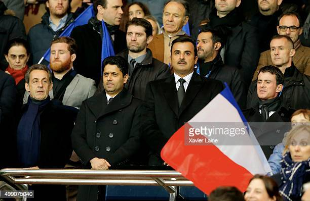 Nicolas Sarkozy Nasser Al Khelaifi Tamim ben Hamad Al Thani and French first minister Manuel Valls attend the French Ligue 1 between Paris...