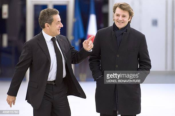 Nicolas Sarkozy the newly elected head of the French rightwing opposition UMP party and former president of France walks with Francois Baroin mayor...
