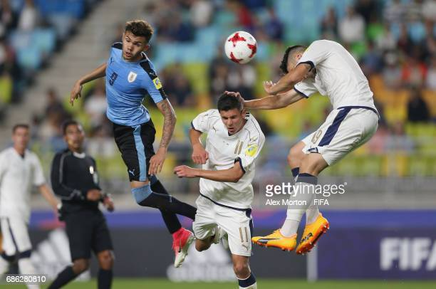 Nicolas Schiappacasse jumps for the ball with Matteo Pessina and Riccardo Marchizza of Italy during the FIFA U20 World Cup Korea Republic 2017 group...
