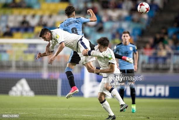 Nicolas Schiappacasse of Uruguay is challenged byi Matteo Pessina of Italy and Giuseppe Scalera of Italy during the FIFA U20 World Cup Korea Republic...
