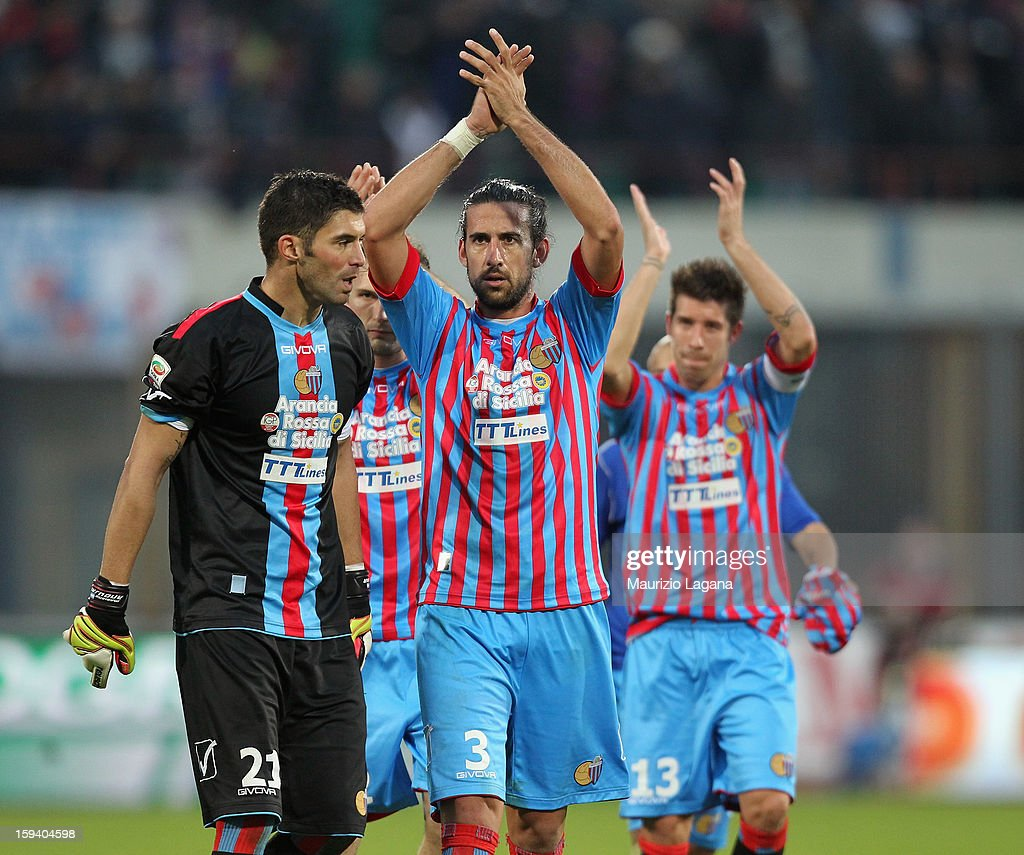 Nicolas Spolli (C) and Mariano Andujar of Catania celebrate during the Serie A match between Calcio Catania and AS Roma at Stadio Angelo Massimino on January 13, 2013 in Catania, Italy.