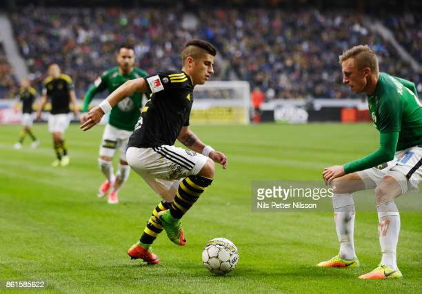 Nicolas Stefanelli of AIK and Joakim Karlsson of Jonkopings Sodra competes for the ball during the Allsvenskan match between AIK and Jonkopings Sodra...