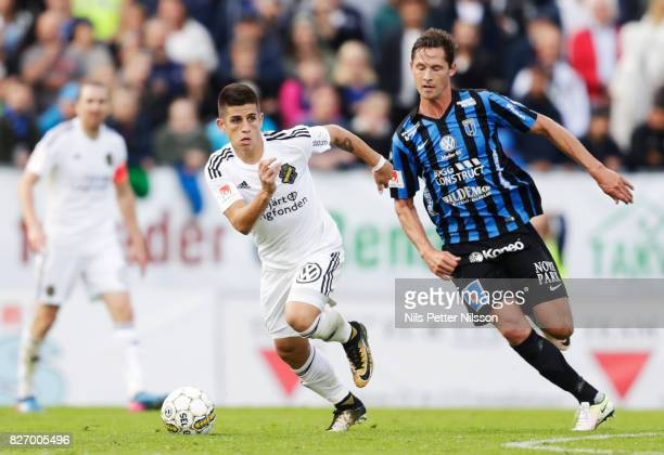 Nicolas Stefanelli of AIK and Philip Haglund of IK Sirius FK competes for the ball during the Allsvenskan match between IK Sirius FK and AIK at...