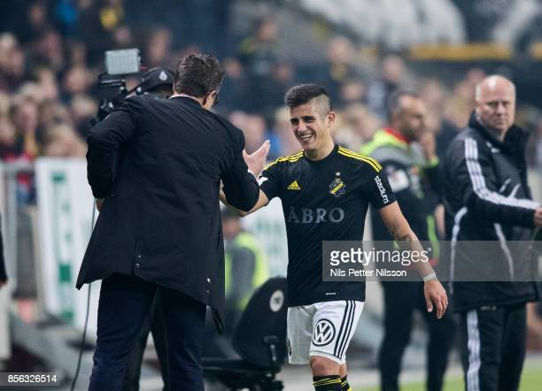 Nicolas Stefanelli of AIK shakes hands with Rikard Norling head coach of AIK during the Allsvenskan match between AIK and IF Elfsborg at Friends...