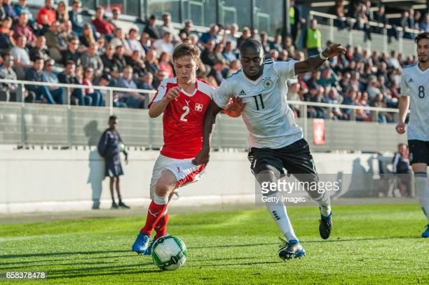 Nicolas Stettler of Switzerland vies with Amara Conde of Germany during the U20 international friendly match between U20 Switzerland and U20 Germany...