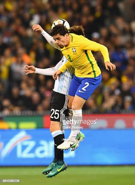 Nicolas Tagliafico of Argentina and Fagner Lemos of Brazil compete to head the ball during the Brazil Global Tour match between Brazil and Argentina...