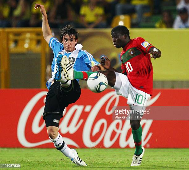 Nicolas Tagliafico of Argentina is challenged by Sana of Portugal during the FIFA U20 World Cup 2011 quarter final match between Portugal and...