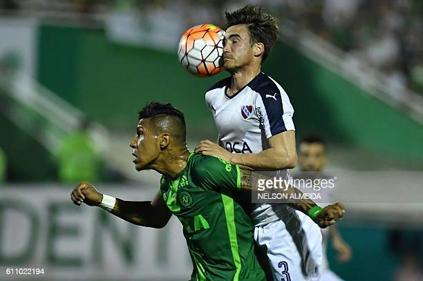 Nicolas Tagliafico of Argentina's Independiente heads the ball over Ailton Canela of Brazil's Chapecoense during their Sudamericana Cup football...