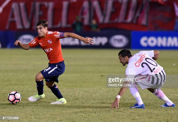 Nicolas Tagliafico of Argentina's Independiente vies for the ball with Antonio Bareiro of Paraguay's Libertad during their Copa Sudamericana first...