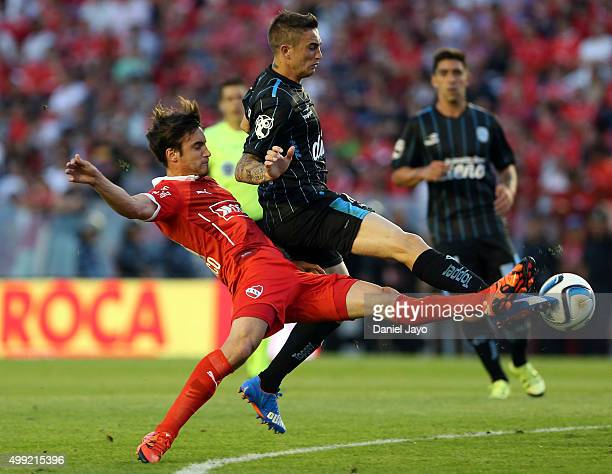 Nicolas Tagliafico of Independiente and Ricardo Noir of Racing Club fight for the ball during a first leg match between Independiente and Racing Club...