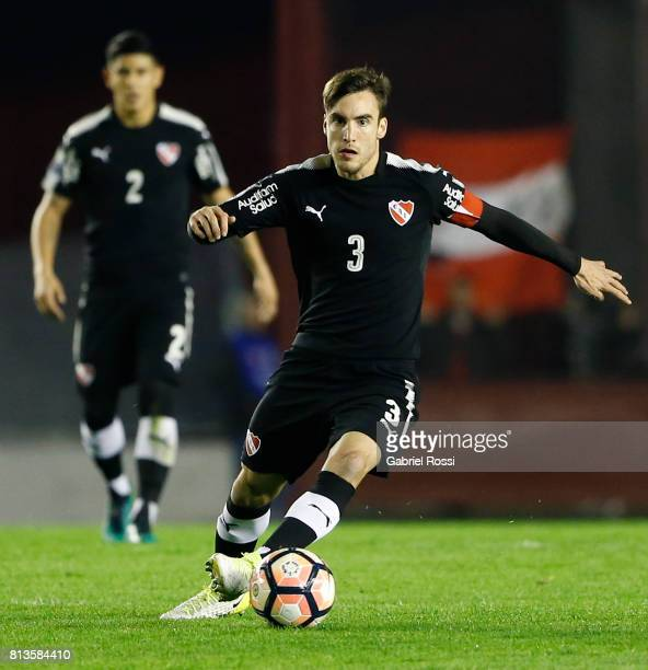 Nicolas Tagliafico of Independiente drives the ball during the first leg match between Independiente and Deportes Iquique as part of second round of...