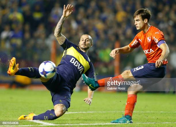 Nicolas Tagliafico of Independiente fights for the ball with Dario Benedetto of Boca Juniors during a match between Boca Juniors and Independiente as...