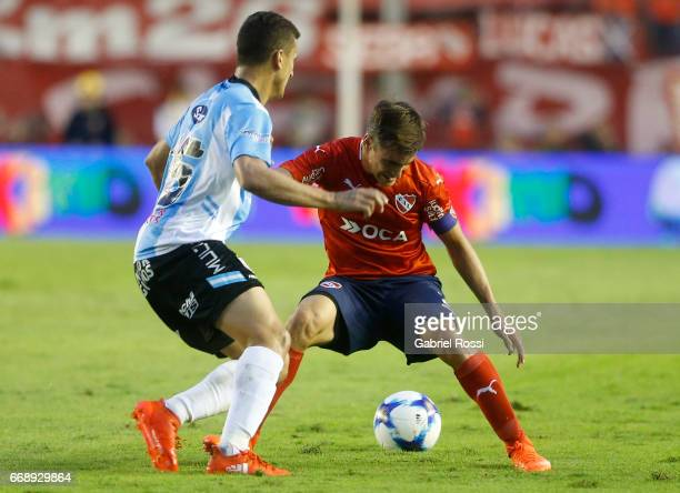 Nicolas Tagliafico of Independiente fights for the ball with Emiliano Romero of Atletico Rafaela during a match between Independiente and Atletico de...