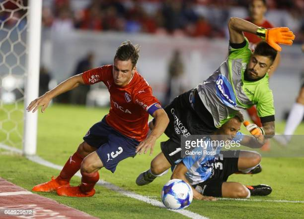 Nicolas Tagliafico of Independiente fights for the ball with Lucas Hoyos of Atletico Rafaela during a match between Independiente and Atletico de...
