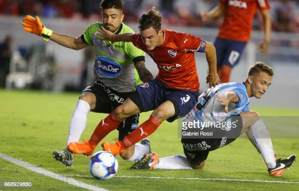 Nicolas Tagliafico of Independiente fights for the ball with Lucas Hoyos goalkeeper of Atletico Rafaela during a match between Independiente and...