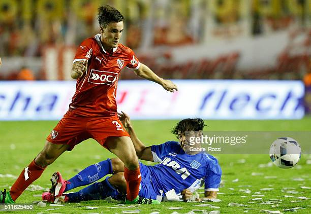 Nicolas Tagliafico of Independiente fights for the ball with Oscar Romero of Racing Club during the 4th round match between Independiente and Racing...