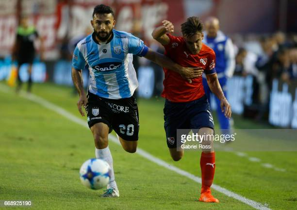 Nicolas Tagliafico of Independiente fights for the ball with Oscar Carniello of Atletico Rafaela during a match between Independiente and Atletico de...