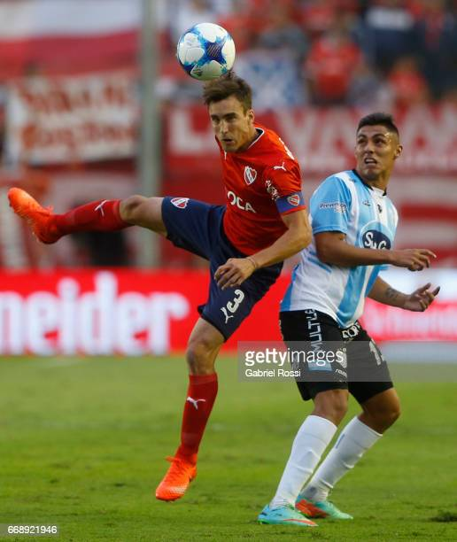 Nicolas Tagliafico of Independiente goes for a header with Diego Montiel of Atletico Rafaela during a match between Independiente and Atletico de...