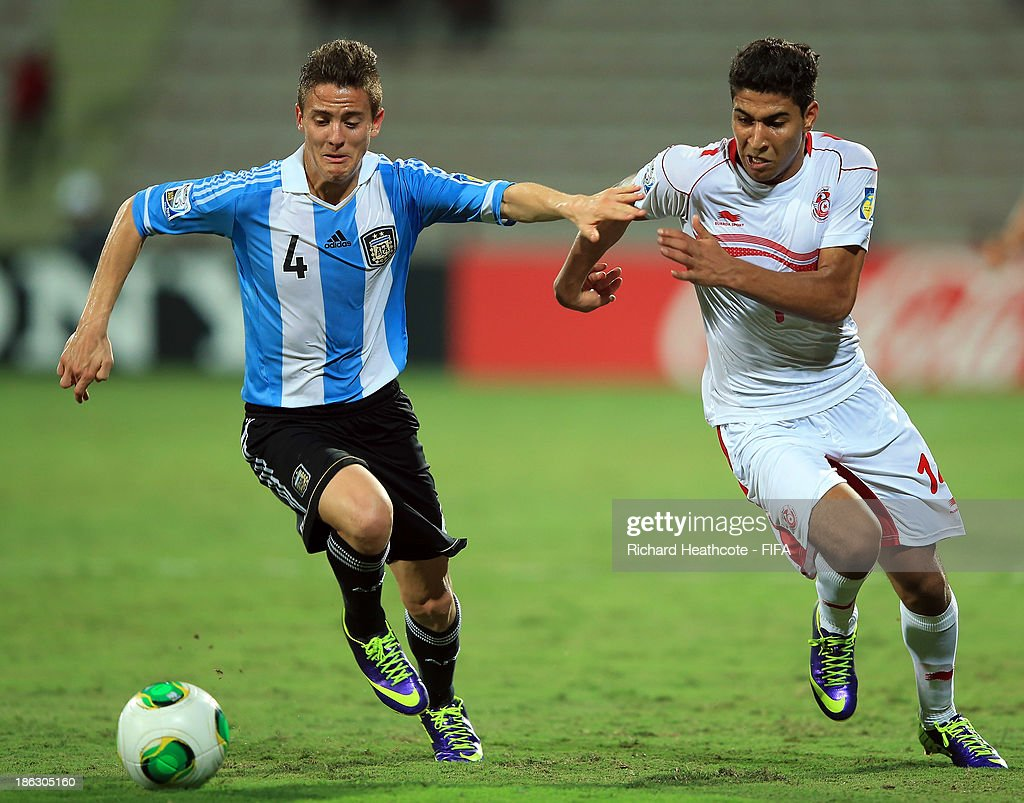 Nicolas Tripichio of Argentina battles with Nidhal Ben Salem of Tunisia during the FIFA U-17 World Cup UAE 2013 round of 16 match between Argentina and Tunisia at the Rashid Stadium on October 29, 2013 in Dubai, United Arab Emirates.