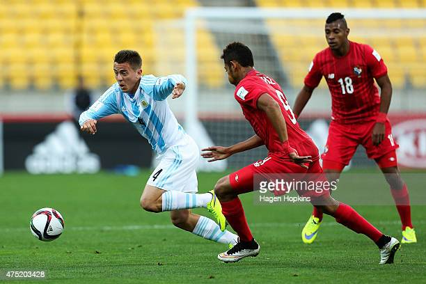 Nicolas Tripichio of Argentina looks to evade the challenge of Ismael Diaz of Panama during the Group B FIFA U20 World Cup New Zealand 2015 match...