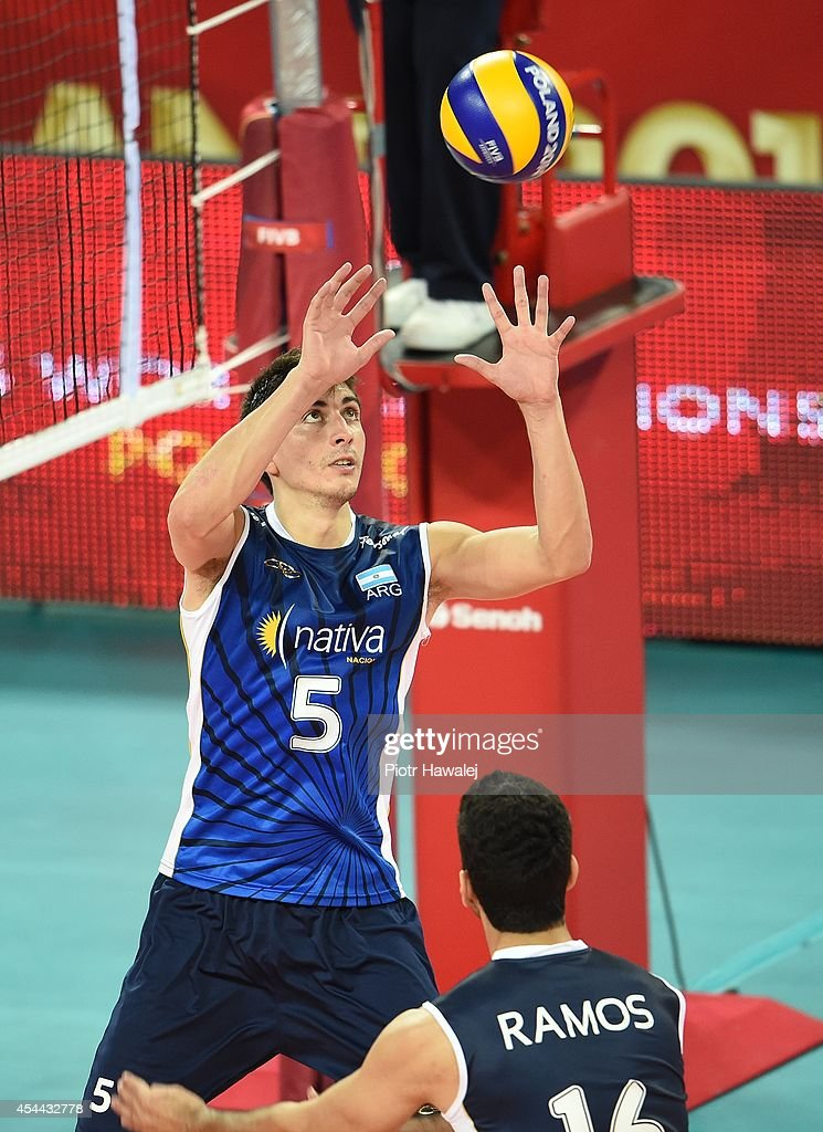 Nicolas Uriarte of Argentina setting up during the FIVB World Championships match between Venezuela and Argentina on August 31, 2014 in Wroclaw, Poland.