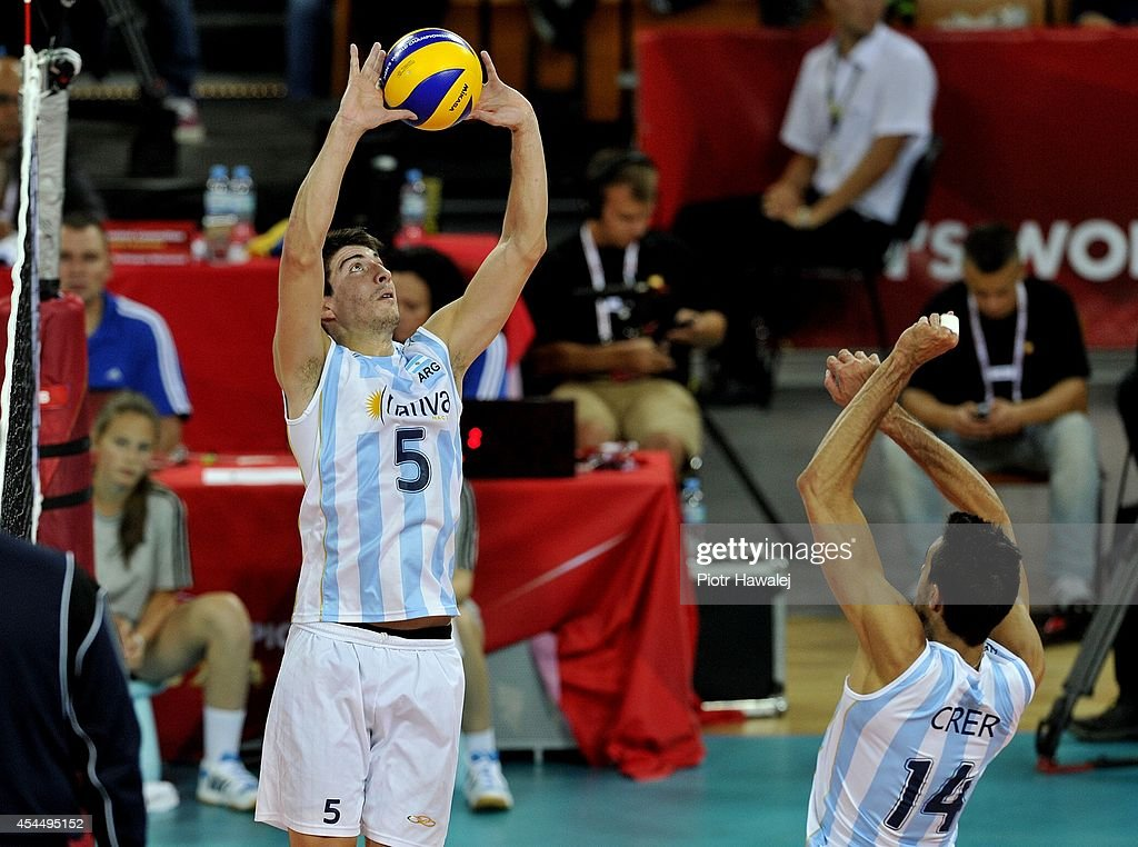 Nicolas Uriarte of Argentina setting up during the FIVB World Championships match between Serbia and Argentina on September 2, 2014 in Wroclaw, Poland.