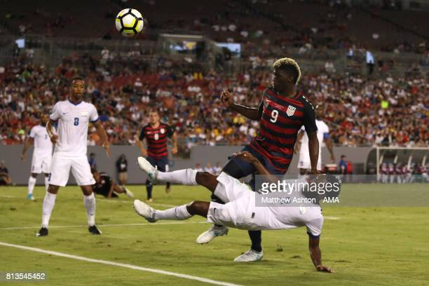 Nicolas Zaire of Martinique competes with Gyasi Zardes of the United States during the 2017 CONCACAF Gold Cup Group B match between the United States...