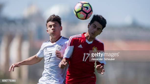 NicolasGerrit Kuehn of Germany challenges Aram Khamoyan of Armenia during the UEFA U17 elite round match between Germany and Armenia on March 23 2017...