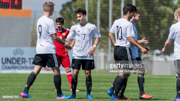NicolasGerrit Kuehn of Germany JannFiete Arp of Germany celebrate a goal during the UEFA U17 elite round match between Germany and Armenia on March...