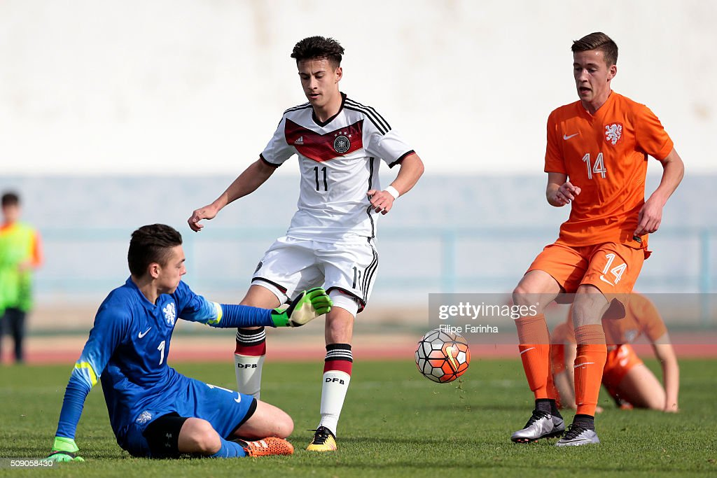 Nicolas-Gerrit Kuhn of Germany challenges Jasper Schendelaar of Netherlands during the UEFA Under16 match between U16 Germany v U16 Netherlands on February 8, 2016 in Vila Real de Santo Antonio, Portugal. (Photo by Filipe Farinha/Bongarts/Getty Images