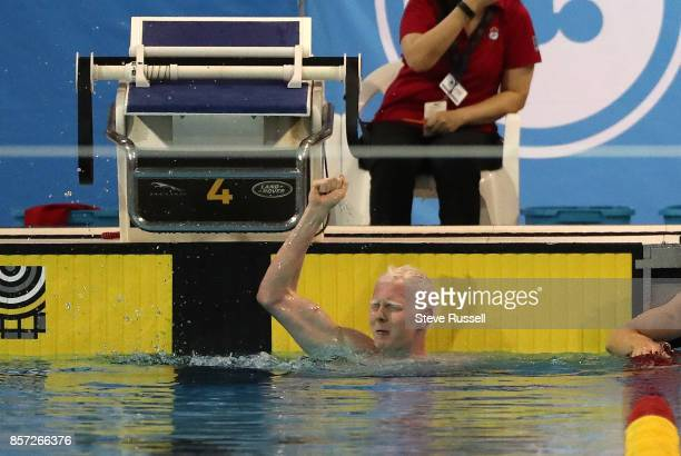 TORONTO ON OCTOBER 3 NicolasGuy Turbide celebrates after setting a Canadian Record in the men's S13 100 metres backstroke as the Paraswimming...
