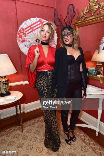 Nicole Abate and Elizabeth Suarez attend MichelleMarie Heinemann and Hyacinth Cornelia Heinemann host Halloween Cocktails at The Carlyle at The...