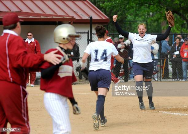Nicole Adams and Abi Buchler of Messiah College celebrate the final out of their win over Coe College in the Division III Women's Softball...