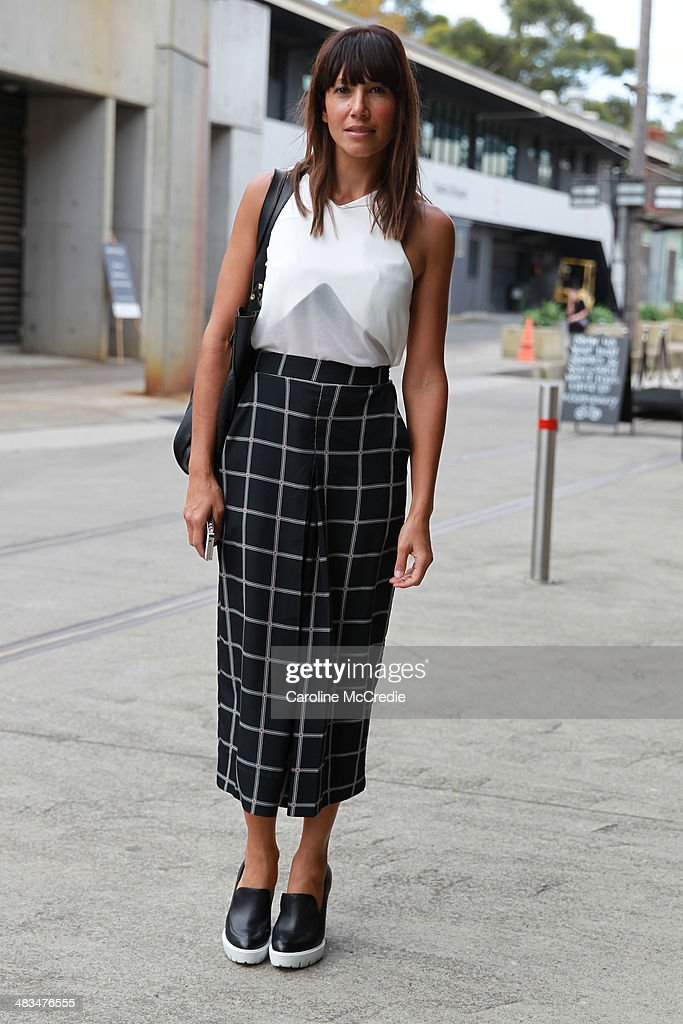 Nicole Adolphe poses wearing a Cameo top, Shona Joy pants, and Whitney shoes at Mercedes-Benz Fashion Week Australia 2014 at Carriageworks on April 9, 2014 in Sydney, Australia.