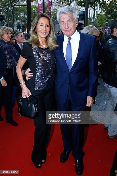 Nicole and Gilbert Coullier attend the 'Le nouveau Stagiare' movie Premiere to Benefit 'Claude Pompidou Foundation' held at Cinema 'UGC Normandie' on...