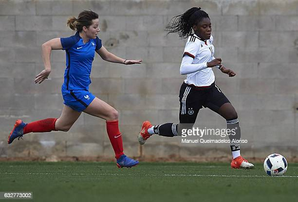 Nicole Anyomi of Germany is put under pressure from Eva Kouache of France during the international friendly match between U17 Girl's Germany and U17...