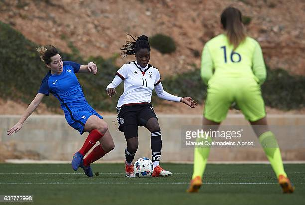 Nicole Anyomi of Germany is tackled by Eva Kouache of France during the international friendly match between U17 Girl's Germany and U17 Girl's France...