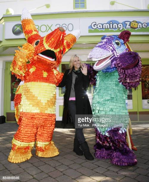 Nicole Appleton poses with characters from the video game Viva Pinata during the launch of the Xbox 360 Gaming Zone at Legoland in Windsor