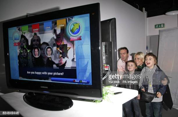 Nicole Appleton with her son Gene and stepson Lennon trying out the Xbox video game 'You're in the Movies' during the launch of the Xbox 360 Gaming...