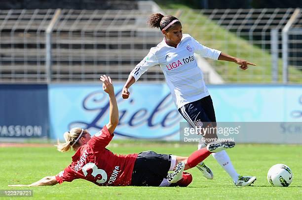Nicole Banecki of Muenchen is challenged by Kerstin Boschert of Freiburg during the Women's Bundesliga match between SC Freiburg and Bayern Muenchen...