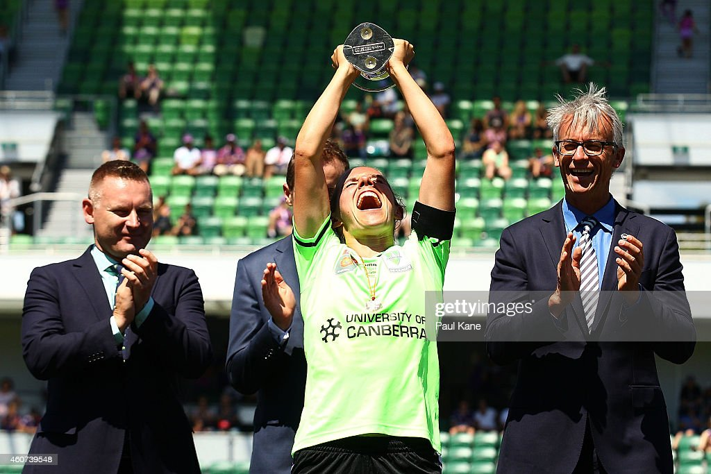 Nicole Begg of Canberra holds the trophy aloft after winning the WLeague Grand Final match between Perth and Canberra at nib Stadium on December 21...
