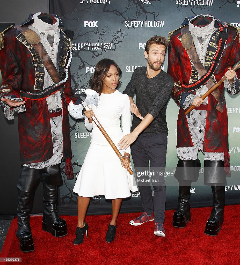 Nicole Beharie (L) and Tom Mison arrive at Fox's 'Sleepy Hollow' special screening held at Hollywood Forever on June 2, 2014 in Hollywood, California.