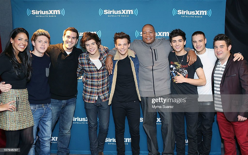 Nicole Biggins, Niall Horan, Rich Davis, Harry Styles, Louis Tomlinson, Stanley T. Evans, Zayn Malik, Liam Payne and Ryan Sampson pose for photo during One Direction's performance on SiriusXM's 'Artist Confidential' Series at SiriusXM Studios on December 7, 2012 in New York City.