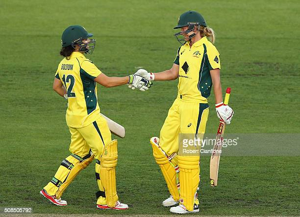 Nicole Bolton acknowledges Meg Lanningof Australia after she reached her half century during game two of the women's one day international series...