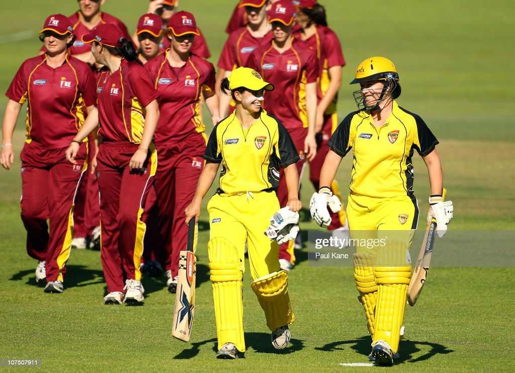 Nicole Bolton and Lauren Stammers of the Fury walk from the field after winning the WNCL Twenty20 match between the Western Australia Fury and the...